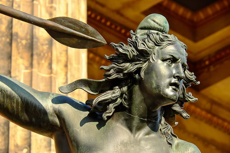 Closeup of male statue holding spear
