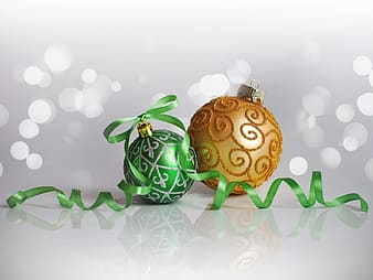 Two green and yellow ornaments