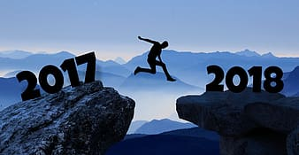 Silhouette of person jumping front 2017 to 2018 cliff