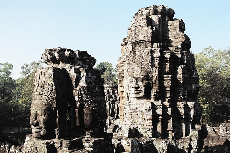 Stone ancient ruins with carved faces