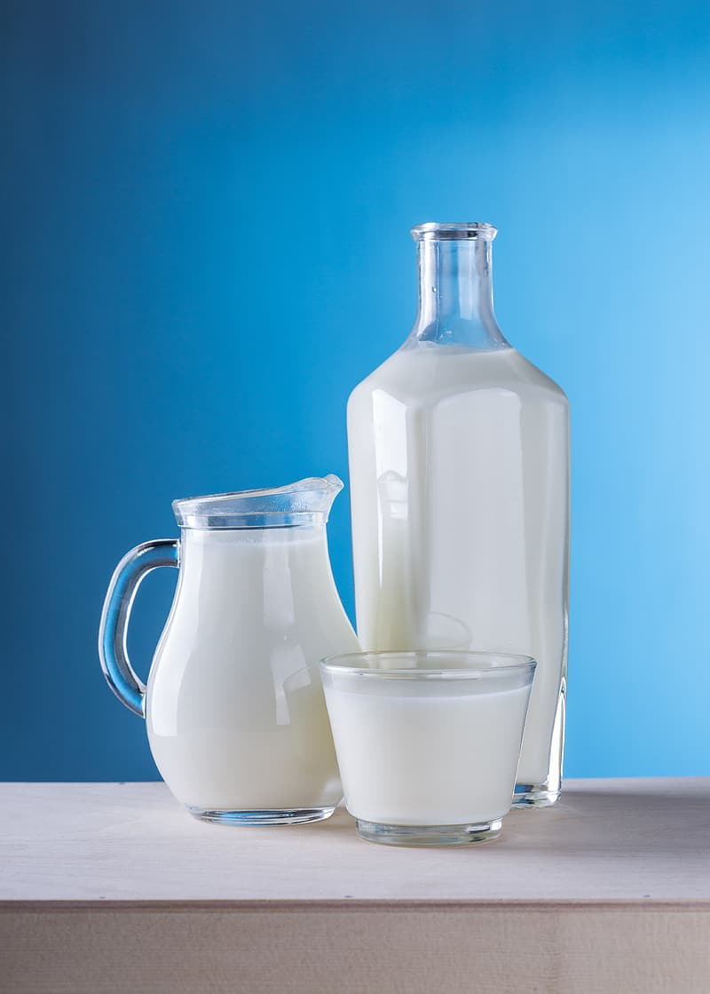 Clear glass pitcher filled with milk
