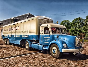 Blue and white transport truck