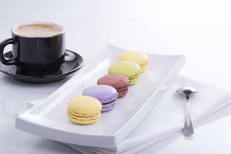 Macaroons on rectangular white ceramic plate