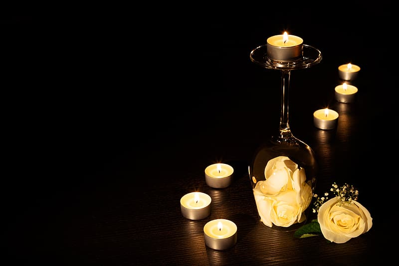 Brass-colored candle stand and candles