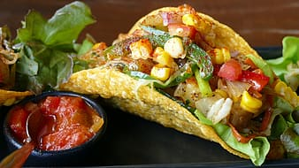Taco with vegetables and corn with sauce