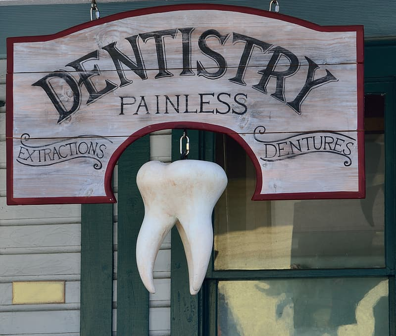 Gray and red Dentistry Painless signage with tooth decor