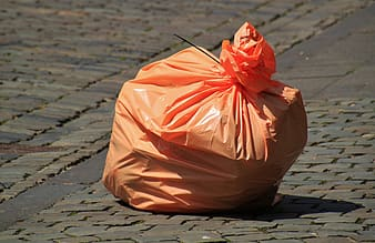 Photo of orange plastic garbage bag