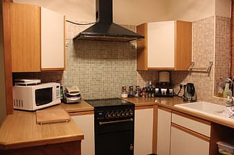 White countertop microwave near kitchen cabinet