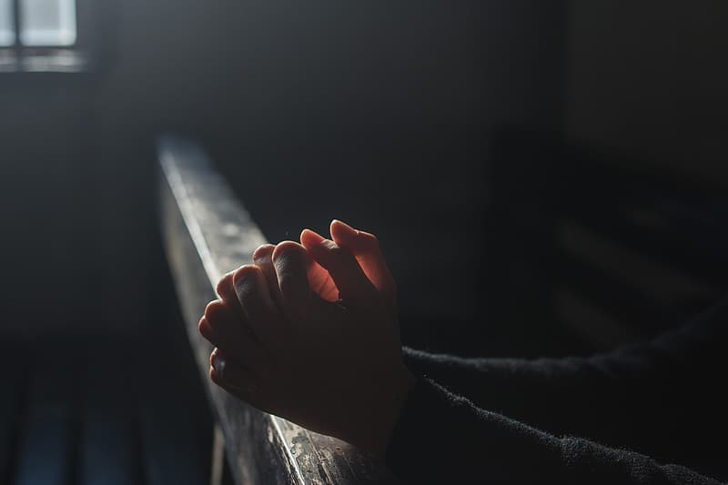 Hands Praying in Church
