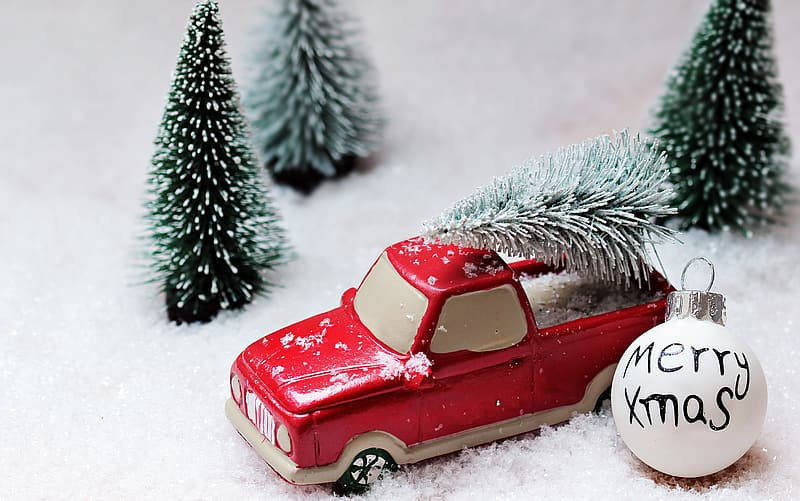 Red pickup truck ornament with trees