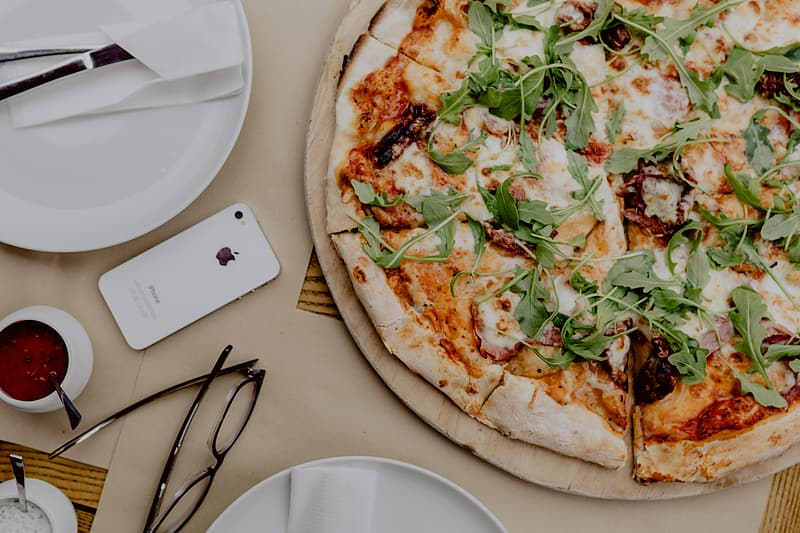 Eating delicious pizza in a cozy restaurant
