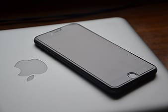 Black iPhone 7 and MacBook