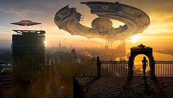 White space craft hovering above buildings during sunset