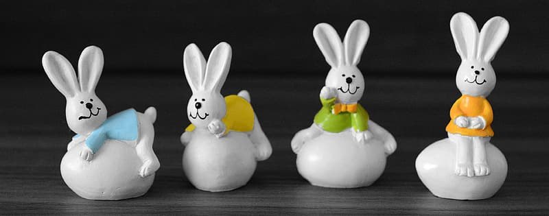 Four rabbits figurines
