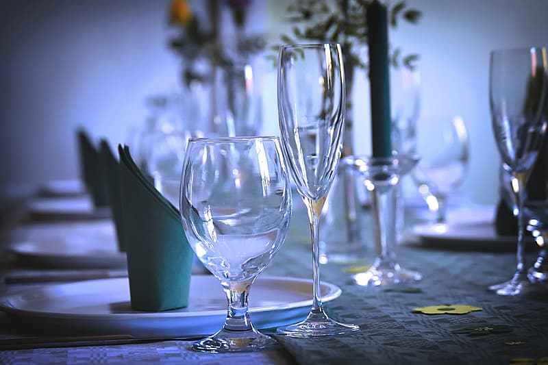 Clear wine glasses on table