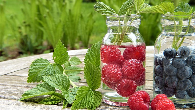 Strawberry on mason jar filled with water