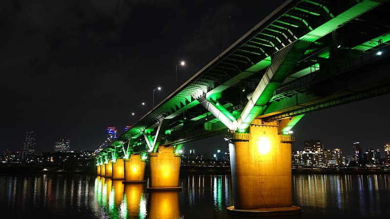Lighted concrete bridge during night