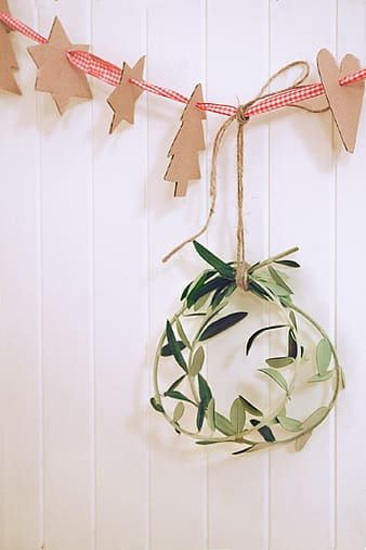 Two green hanging decor hanged on wall