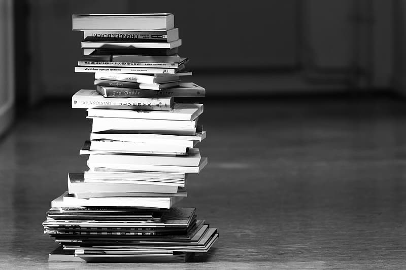 Greyscale photography of book lot