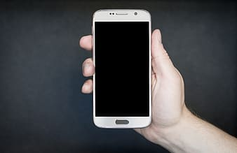 Person holding white Android smartphone