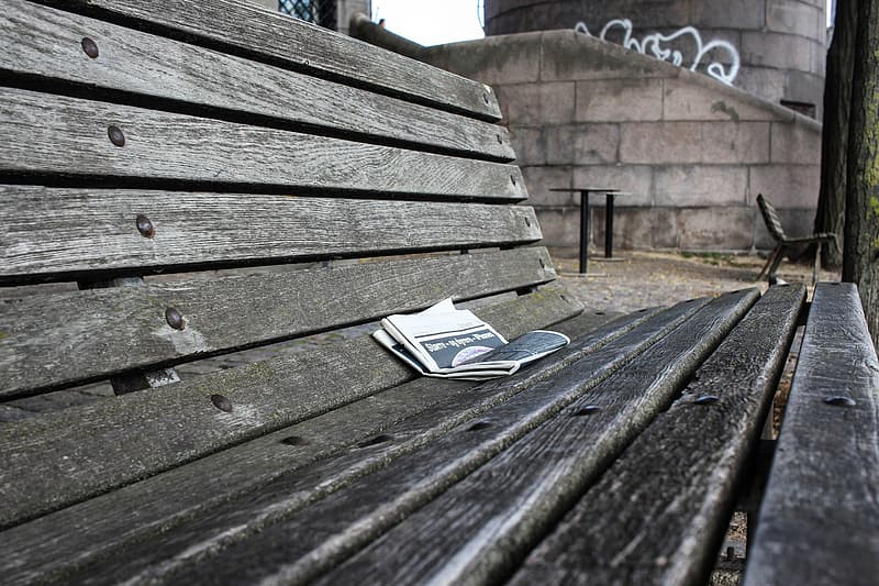 White book on brown wooden bench