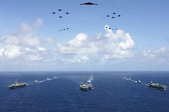 Fleet of navy traveling on sea