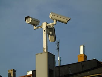 White and gray security camera