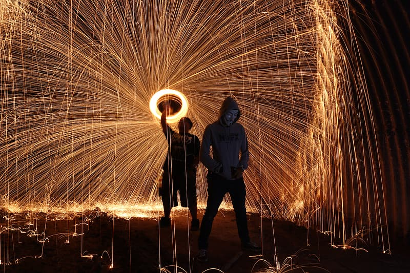Long exposure photography of person spinning fireworks