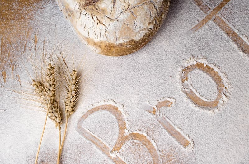 Wheat stalks on table with flour