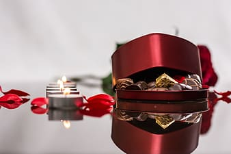 Tealight candles beside red box