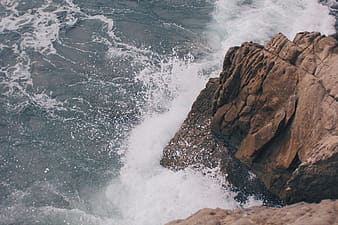 Rock cliff with ocean wave