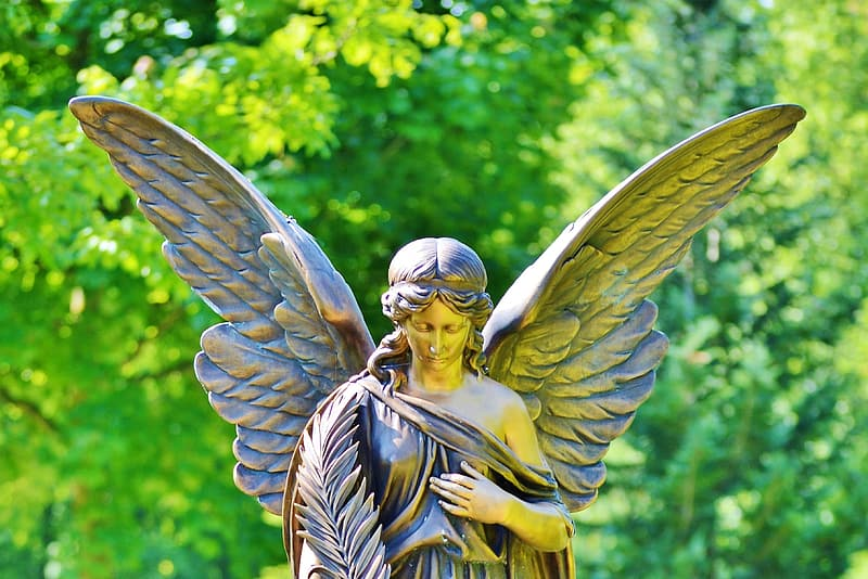 Gold-colored female angle statue outdoors