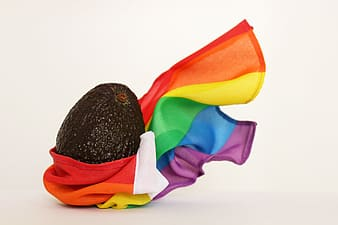 Avocado fruit wrapped on LGBT flag