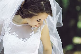 Woman in white wedding dress with veil in close-up photo