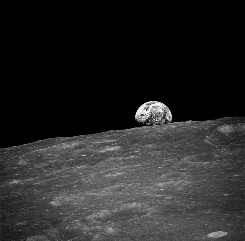 Gray scale photo of earth as viewed from the moon's surface