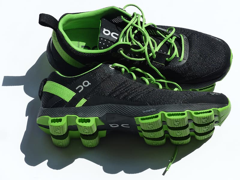 Pair of black-and-green running shoes