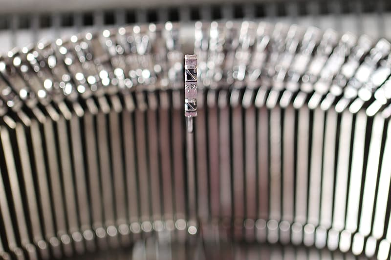 Shallow depth of field photo of gray typewriter letter rod