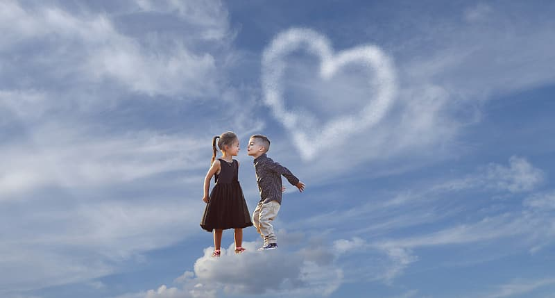 Boy and girl on cloud during daytime