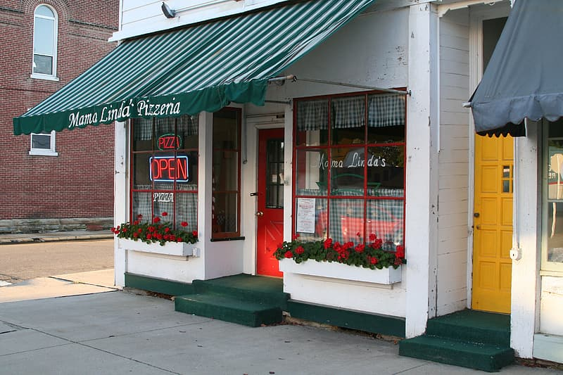 White store with green awning