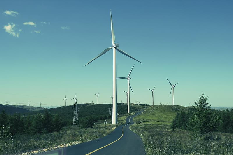Photography of wind turbines under clear blue sky during daytime