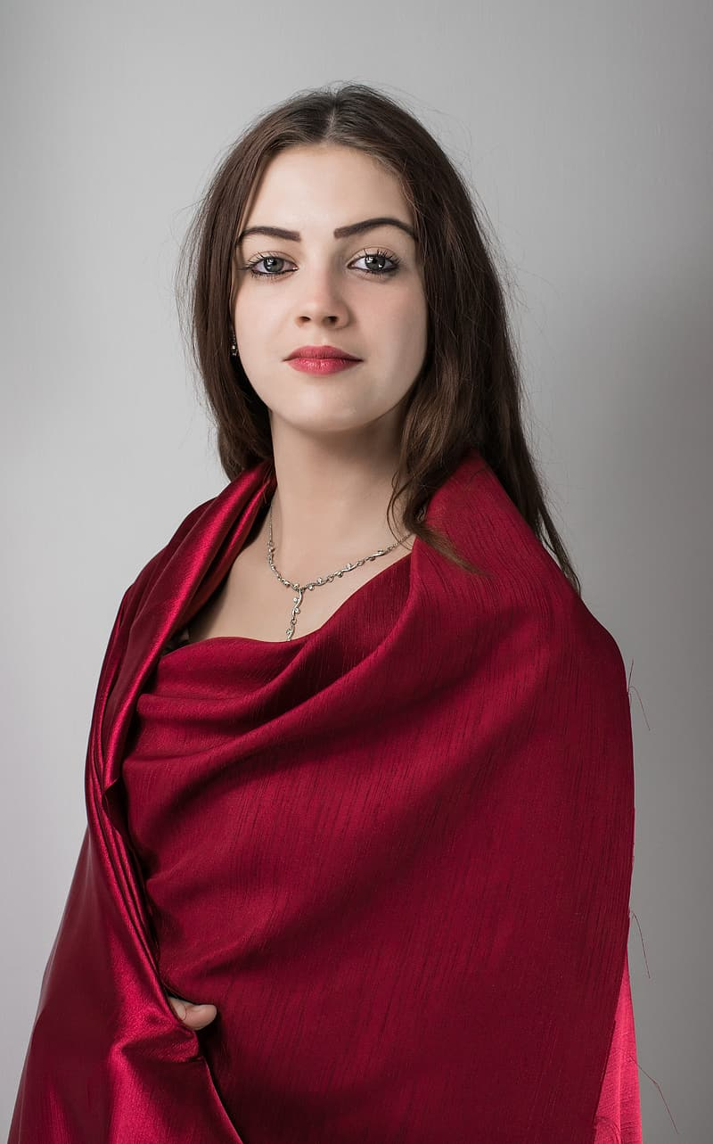 Woman wearing red silk textile