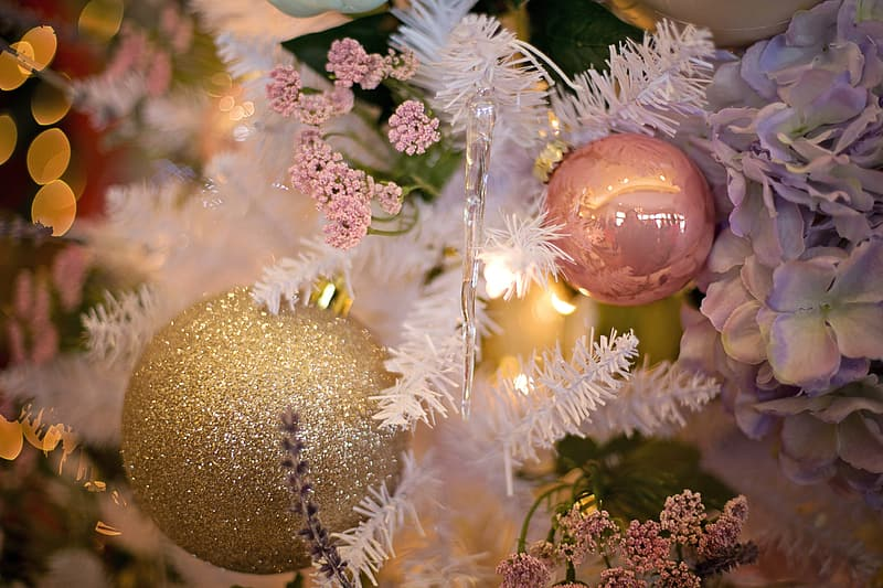 Gold baubles on white christmas tree