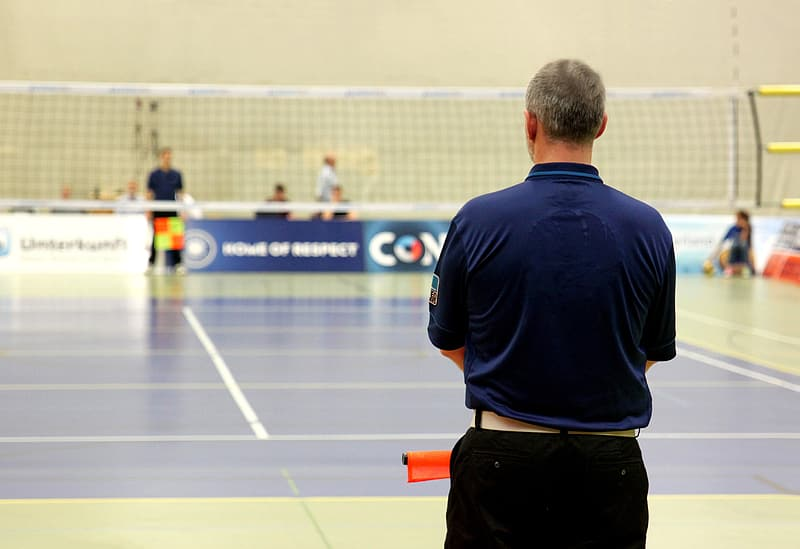 Man in front of volleyball net