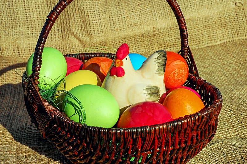 Assorted-color eggs in brown basket