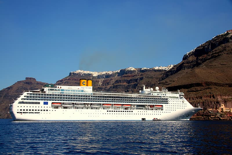 White cruise ship in body of water