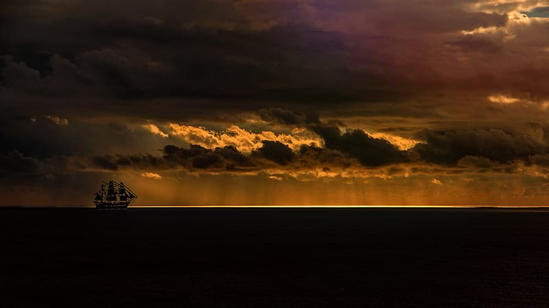Silhouette photography of white sailing ship on sea
