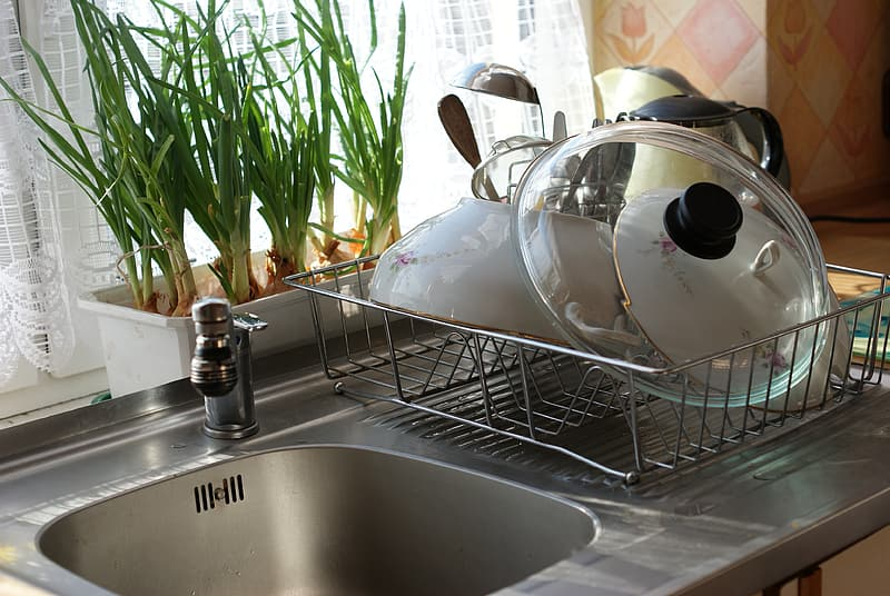 Dishes on dish rack beside sink