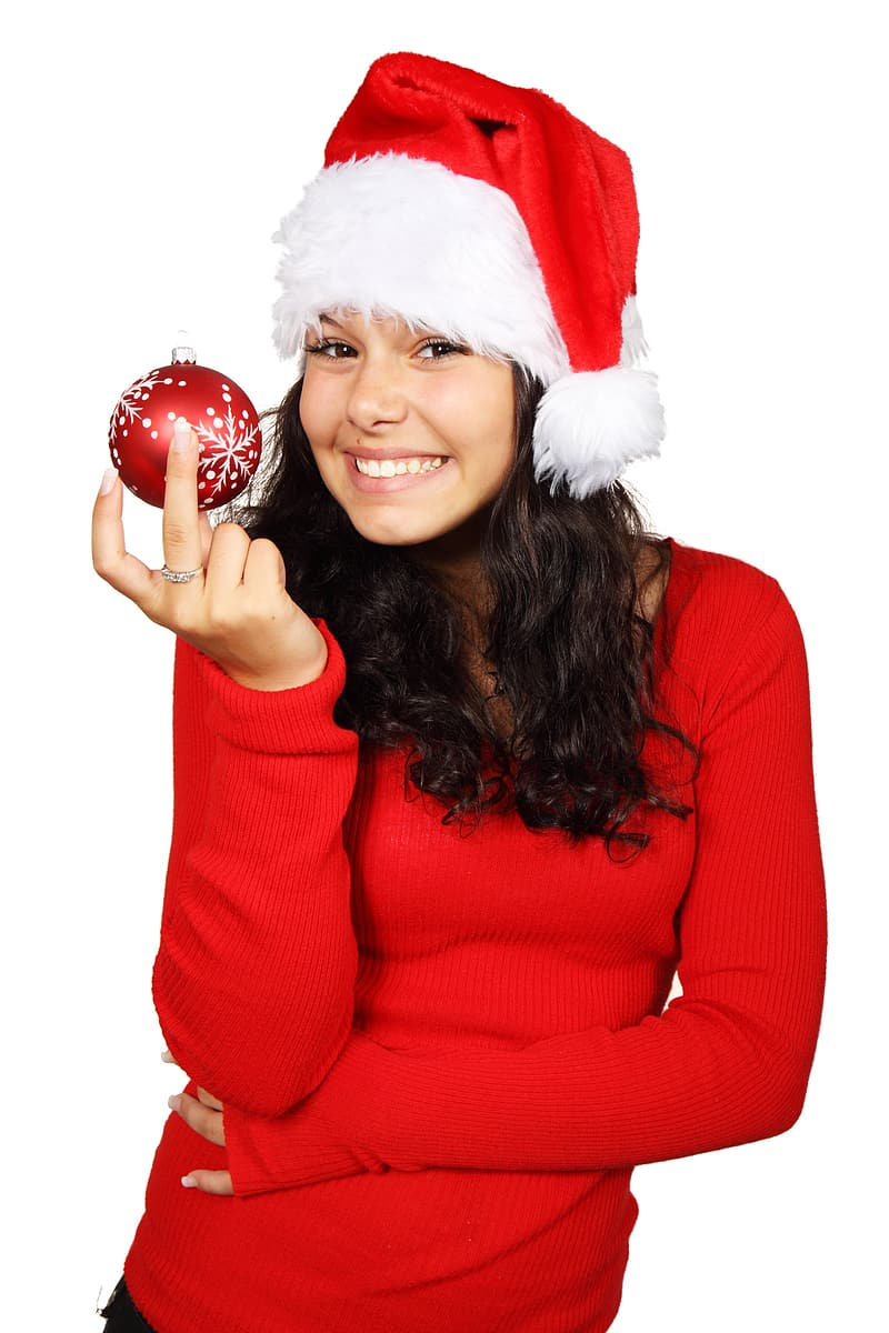 Woman in red sweater holding red Christmas bauble