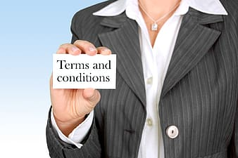 Person holding terms and conditions paper