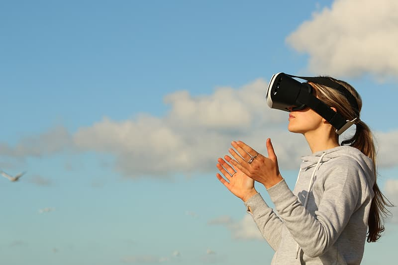 Woman wearing black and white VR goggles